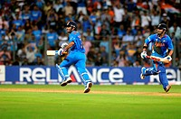 Indian batsman L Gautam Gambhir, MS Dhoni running between wickets during the 2011 ICC World Cup Final between India and Sri Lanka at Wankhede Stadium ...