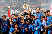 Indian cricketers celebrate with the ICC World cup trophy after beating Sri Lanka in the ICC Cricket World Cup 2011 final match at The Wankhede Stadiu...