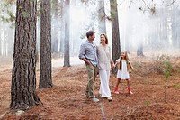 Happy family walking in woods