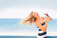 Woman tossing her hair on beach