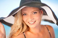 Woman wearing floppy hat outdoors