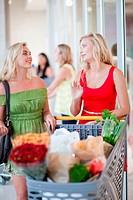 Women pushing shopping cart