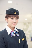 Smiling Chinese flight attendant