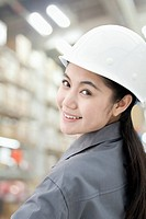 Smiling Chinese factory worker