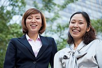 Chinese businesswomen smiling outdoors