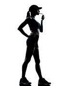 one caucasian woman runner jogger smoking in silhouette studio isolated on white background