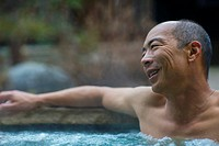 Chinese man relaxing in hot tub