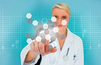 Blonde doctor using touchscreen displaying chemical formula