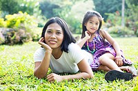 Mother and daughter playing in a garden
