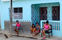 Y7S-1902641 Women and young girl sitting in front of house in Remedios Villa Clara Province Cuba