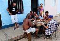 Group of peope playing dominos on the street of Santa Clara,Villa Clara Province,Cuba