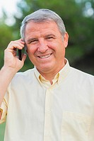 Smiling grey haired man on the phone