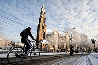 Amsterdam in winter. A cylist rides his bike past Westerkerk after a snowfall in Amsterdam, the Netherlands, 10 February 2013