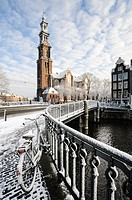 Amsterdam in winter. Westerkerk and bridge over Prinsengracht canal, Amsterdam, the Netherlands