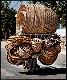Man transporting baskets on a moped ,Cambodia