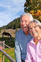 Germany, Bavaria, Senior couple on mountain hike near Wendelstein