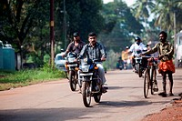 MOTORCYCLES ON A STREET IN NEDUNGOLAM, KERALA, SOUTHERN INDIA, ASIA