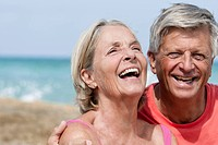 Spain, Senior couple at beach, smiling