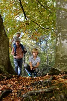Germany, Bavaria, Father and sons in forest