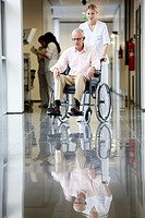 Nurse with patient in wheelchair, Corridor, Onkologikoa Hospital, Oncology Institute, Case Center for prevention, diagnosis and treatment of cancer, D...