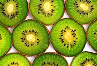 Kiwi fruit slices isolated on white background
