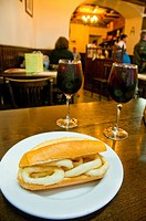 Fried squids sandwich with sangria in a typical bar. Madrid, Spain