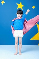 a girl posing like a superwoman with a pink cape around her neck