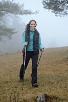 Brunette young woman Nordic walking