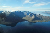 Snowcapped mountains and fjord landscape, Troms, Norway, aerial photo