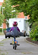 Mischievous toddler on a bike