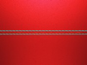 Red luxury stitched leather background