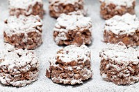 Chocolate cornflake squares dusted with icing sugar