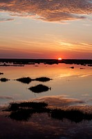 The sun rises over the Chincoteague Bay marshland in Virginia.