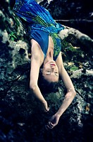 Young woman lying upside down