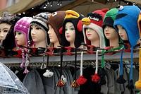 Bruges / Brugge, Belgium. Hats on a Christmas market stall