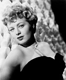 US actress Shelley Winters posing sensual in an evening dress