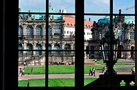 looking through the windows at a famous baroque palace and museum in dresden, the building has been rebuilt after second world war damages