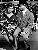 American actress and swimmer Esther Williams sitting on a bench with American actor Red Skelton in the film Naptune's daughter. USA , 1949 . Neptune's...