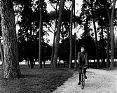 UIG-911-16-AA379244 Italian actress Ilaria Occhini riding a bicycle in the park of Villa Borghese Rome 1964