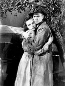 American actor Richard Widmark hugging American actress Lauren Bacall (Betty Jane Perske) in The Cobweb. 1955. The Cobweb, 1955, directed by Vincente ...