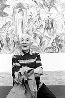 Russian-born French painter Marc Chagall (Moishe Segal) smiling in front of one of his works. Saint-Paul de Vence, September 1967.