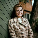 Princess of Iran Soraya (born Soraya Esfandiary-Bakhtiari), the second wife and Queen Consort of the late Shah of Iran, is leaning on the wood entry g...