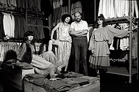 Italian fashion designer and entrepreneur Elio Fiorucci posing with the shop assistants of the shop where the retailers stock up. Milan, 1974.