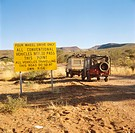 Warning to motorists on outback road, Finke River, Simpson Desert, Northern Territory, Australia