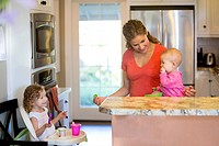 Mother with children in kitchen