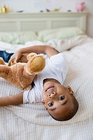 African American boy laying on bed