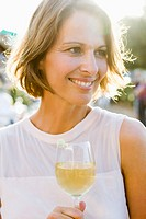 Woman having glass of wine outdoors