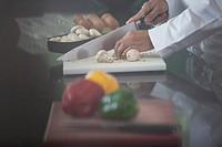 Chef chopping vegetables in restaurant kitchen