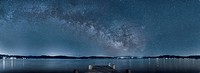 Clouds in night sky over still water
