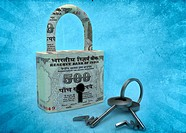 Padlock covered in paper currency with Rupee symbol key